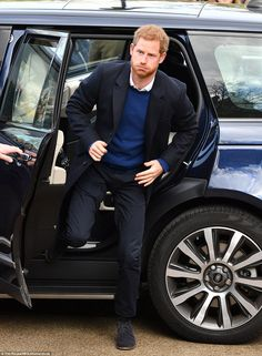 Prince Harry looked dapper - if a tad weary - as he stepped out of the Land Rover in a coordinating blue outfit