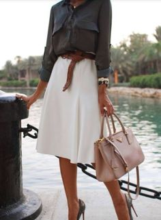 Summer style. Midi skirt with classic blouse.