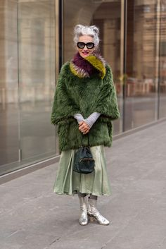 Linda, wearing a fake fur coat I got years ago in Paris, a Dries van Noten collar, a Sies Marjan skirt, and Chanel boots. My style philosophy is to wear what is comfortable and looks good. Green Fur Coat, Ropa Shabby Chic, Stylish Older Women, Chanel Boots, Looks Street Style, Advanced Style, Cool Street Fashion, New York Fashion Week Street Style, Mode Inspiration