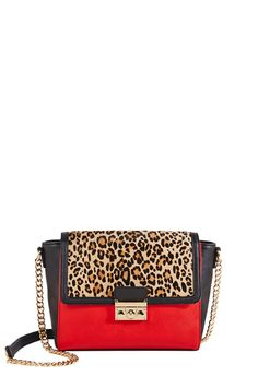 Now THIS is a shoulder bag! Add a little extra rawr to your style  with Elated by JustFab.