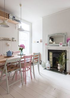 Pastel painted mismatched chairs look brilliant around a dining table! // Caroline & Simon's Modern Vintage Maisonette in London — House Tour Mismatched Dining Room, Interior Design, House Interior, Vintage House, Vintage Kitchen, Home, Interior, London House, Home Decor