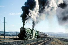 """The hills to the east of Bathurst echo to the sounds of the """"Mail"""" battling Raglan Bank, stirring memories of grander times. Flying Scotsman, Rail Transport, Train Pictures, Steam Engine, Steam Locomotive, Train Tracks, Climbing, Maine, Transportation"""