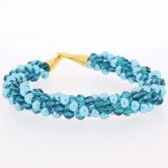 Kumihimo Bracelet - Tempting Turquiose  You must have a go at these bracelets, they are so easy to make and very pretty. They come with full instructions for you to use. I am sure all your friends will be asking you to make one, but don't tell them it only cost £4.99.