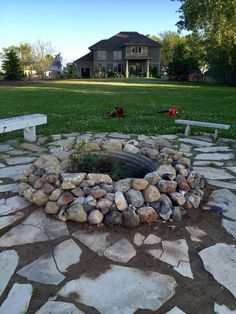 Build your own fire pit with field stones and a scrap culvert pipe