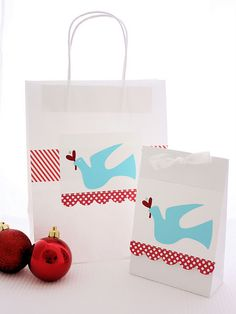 Nice way to embellish a plain paper bag to make it gift-ready❣—white bags with red bunting & aqua dove.