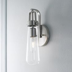 """Blending modern aesthetic with industrial-chic design, this vial-shaped clear glass is suspended by a Brushed Nickel or Blackened Bronze industrial bracket. 60 watts max (medium base socket, 20 watt T9 vintage bulb included). (14.125""""Hx5.5""""Wx5""""D)Backplate: 5.5"""" diameter"""