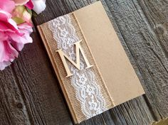 This shabby chic guest book adds a perfect touch to any southern, country, vintage, rustic, or burlap wedding.  The book comes with a wide burlap