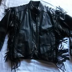 EUC Harley Davidson Leather Jacket Size 38/10 EUC Black Leather Harley Davidson Jacket Has Leather Lacing Across Shoulders & Fringe Down Each Side Front & Back, Quilted Lining, Front Snaps w/Hidden Zipper w/Harley Davidson Pull Tab, Elastic Across The Back At The Waist For More Fitted Feel, Elastic at the cuffs also, 2 Outside Pockets 1 Button Up Inside Pocket Made In The USA Only Worn A Handful of Times Jackets & Coats