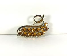 A personal favorite from my Etsy shop https://www.etsy.com/listing/198916889/amber-brown-brooch-rhinestone-brooch