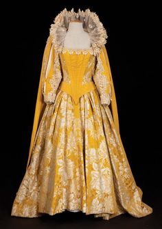 Golden yellow Brocade gown worn by Bette Davis in the film, 'Elizabeth I.'    Surprisingly, many of the older Hollywood films payed more attention to costume historical accuracy than have modern filmmakers.