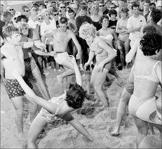 Teenagers twisting on the beach, Florida. 1960s
