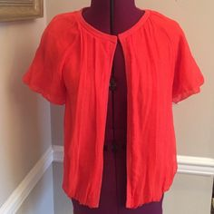 NWOT RARE JCrew Silk/Wool cardigan, Orange, Sz M Very Rare, JCrew bright Orange Cardigan with one hook eye clip on top. Wool cashmere blend lining with 100 % silk she'll. Size Medium. Still has the security tag to be removed after purchase. I never wore this piece hoping to do so, now time to let it go to someone that can enjoy this fun edgy piece from old JCrew!  Flat measurements: 17 inches at bust. there is give in the fabric as it is a fluid style. 22 inches in length from highest point…