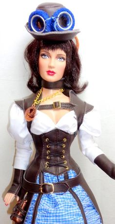 """City Tweed Shauna 16"""" fashion doll from Tonner dressed in the Tornado Traveler steampunk Dorothy outfit with custom made blue suede leather goggles."""