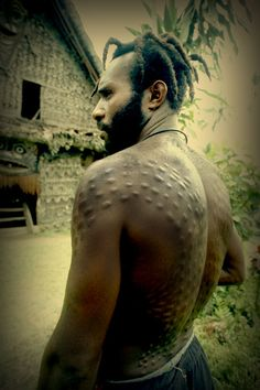 An East Sepik man from the Kaningara tribe with his initiation skin-cutting tattoo depicting the revered crocodile www.papuanewguinea.travel/eastsepik #PapuaNewGuinea