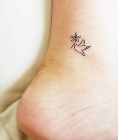 Small dove bird tattoo