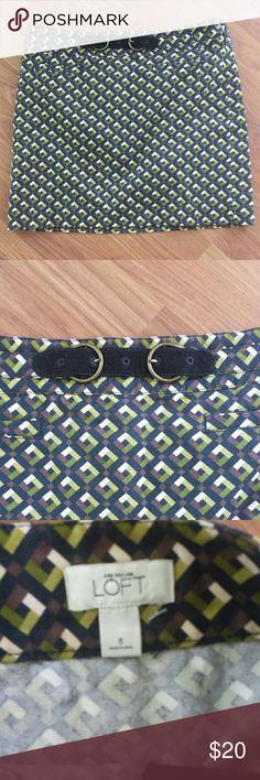 "Ann Taylor Loft skirt Excellent shape. Green, brown ,and black geometric design. Side zipper.  Front slash  pockets with black corduroy faux belt as an accent. 16 1/2"" long. LOFT Skirts Mini"