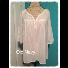 """Old Navy 3/4 Sleeve Blouse Old Navy 3/4 Sleeve V-Neck Blouse. Color: White. Size:  L. V-Neck with a 3 button placket. Thin netted detail strip across chest. Gathered in the shoulders, across the upper back, chest and cuffs. Material is lightweight and is sheer. 53% Cotton, 47% Polyester. Care: Machine wash. Tumble dry. Measures approximately 22"""" from armpit to armpit, and 17"""" from armpit to hem. Old Navy Tops Blouses"""