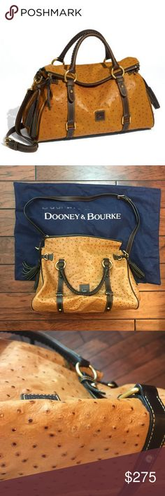 "Dooney & Bourke Ostrich Leather Florentine Satchel This beautiful purse is in excellent condition. There is some very minor fading towards the bottom and on the bottom of the purse (please see pics) If you have any questions, please ask! The purse has handles (approximate 5"" strap drop) and an adjustable, removable, long strap (approximately 38"" long at shortest length and approximately 41"" long at longest length). Purse measures approximately 11""x13"". One zipper pocket inside and 3 slip…"