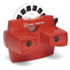 Viewmaster. Still have it !  My grand-parents had the electric viewer with the lamp.  It was like watching slides.   Lots of fun.