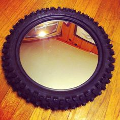 Use a bike tire or something similar. Cute for a kids room or man cave/garage. Dirt Bike Bedroom, Motocross Bedroom, Car Bedroom, Bike Room, Kids Bedroom, Bedroom Decor, Bedroom Ideas, Old Tires, Baby Boy Rooms
