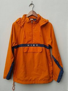 Orange navy blue PULLOVER HOODED nylon NIKE jacket windbreaker with zipper  and front pocket 7027367b2