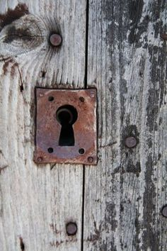 Old rusted lock on weathered wood.