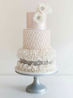 Pretty ruffles and dragees wedding cake
