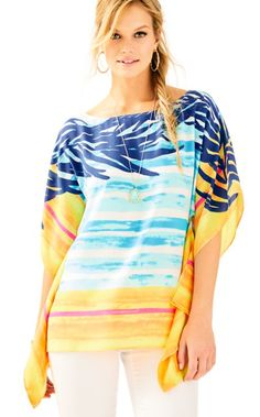 The Rowan Silk Caftan top is an engineered silk caftan. With a botneck and gorgeous masterpiece print, this caftan is a truly special piece.