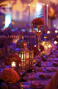 Moroccan Theme Birthday party. Loads of soft lights with purples and golds.
