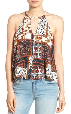 Earthy hues add world-traveler vibes to this cute woven tank styled with a keyhole neck and flirty double-layer hem.