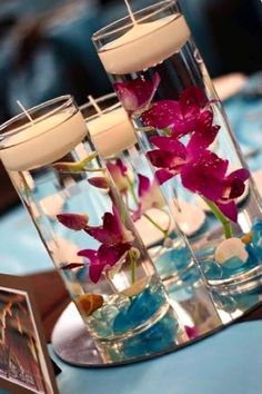 DIY Wedding Centerpieces with orchids and floating candles. Beach Wedding Centerpieces, Wedding Reception Tables, Wedding Decorations, Table Decorations, Diy Centerpieces, Inexpensive Centerpieces, Graduation Centerpiece, Quinceanera Centerpieces, Reception Ideas