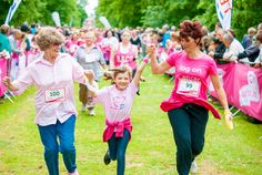 Three generations finishing the Race for Life. [Photography by Kayleigh Poacher]