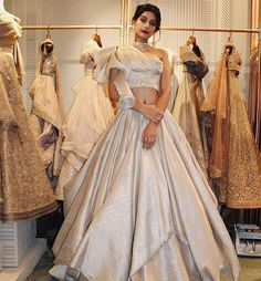 Beige champagne lehenga Passage To India is the mystic glorification of the Indian heritage that embraces it with a fearless gusto and highlights the S&N… Indian Wedding Gowns, Indian Gowns Dresses, Indian Bridal Outfits, Indian Fashion Dresses, Dress Indian Style, Indian Designer Outfits, Bridal Dresses, Indian Designers, India Fashion