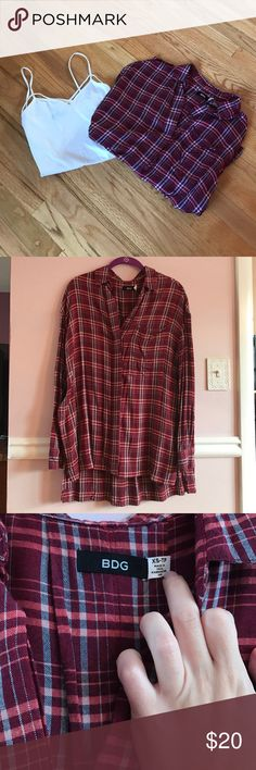 Urban Outfitters Plaid Button Down Shirt Urban's Outfitters (BDG) plaid button down shirt Red with a little bit of blue tint Lightweight Extremely oversized Slits down both sides under the arms Size XS, good condition  -tank not included Urban Outfitters Tops Button Down Shirts