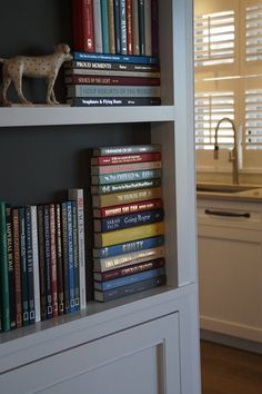 make a box with faux book spines to hide stuff inside for the home