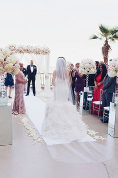The bride walked half way down the aisle on her own before meeting her mother, who gave her away at the end.   Las Vegas Wedding Planner Andrea Eppolito  |  Wedding at Lake Las Vegas  | White and Blush and Grey Wedding | Luxury Wedding Las Vegas