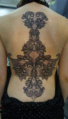 Simply stunning. #inked #Inkedmag #tattoo #back #lace #sexy #placement #idea #pattern