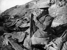 British soldier cleaning a rifle, Western Front, WW1. -BritainsMilitaryHist