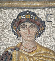 """[TURKEY.EAST 29288] 'Goddess Ktisis in Byzantine mosaic in Urfa.'  Ktisis, goddess of the foundation of buildings and cities, and personification of generosity and donation is depicted here as a richly bejeweled woman. The 5/6 th century floor mosaic can be found in the """"Villa of the Amazons"""", a palatial house, that probably belonged to an important administrator of the Eastern Roman (Byzantine) Empire, who lived in Edessa (nowadays called Urfa). The remains of the villa were discovered in…"""