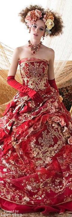 Stella de Libero.  This shows how a red dress with all gold metallic embroidery would be spectacular.