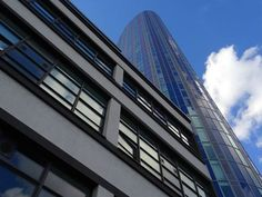 New free stock photo of sky buildings glass via Pexels https://www.pexels.com/photo/architectural-design-architecture-buildings-exterior-543453/