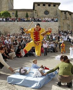Every year during the month of June, the Spanish village of Castrillo de Murcia near Burgos holds its traditional Baby-Jumping Festival as part of its Corpus Christi celebrations. During the act, known as El Colacho, men dressed as the Devil (known as the Colacho) leaps over babies born during the previous twelve months of the year who lie on mattresses in the street.