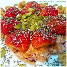 Gluten, dairy and processed sugar free pancake for breakfast with fresh strawberries, chia seeds, raw activated pepitas and pumpkin seeds with a teaspoon of raw organic honey drizzled over the top. #paleo #primal #pancake #colourful #breakfast #glutenfree