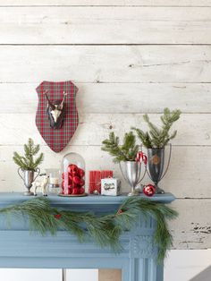 Give your mantel a rustic-preppy look with a resin reindeer ornament and plaid plaque. #decorations #holiday