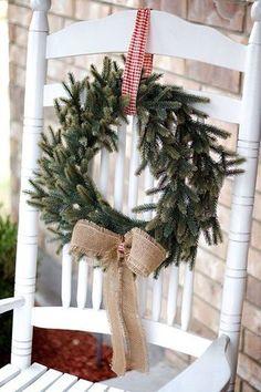 Charming outdoor Christmas Decor.  Love a fresh wreath with bows on white farmhouse furniture...