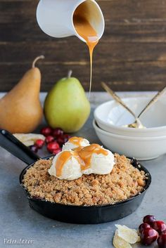 This Pear Cranberry Ginger Crisp is a mix of sweet, tart, and little spicy with a buttery shortbread cookie crumble! This festive holiday dessert is gluten-free and doubles easily.