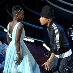Happy! Lupita Nyong'o dances along with Pharrell Williams during his performance of his song from Despicable Me 2
