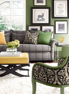 Hmmm! love the grey, green,  black for living room color palette with a nice touch of yellow accent for lift..........classy!