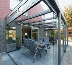 Glass veranda with sliding doors - extend use of outdoor space