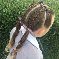 French braids on the head and a round 3D braid raised on both sides.